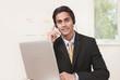 Polite customer service agent listening on headset