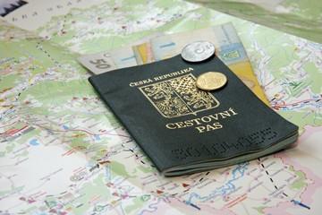 Passport and Ukrainian money on a map of Ukraine