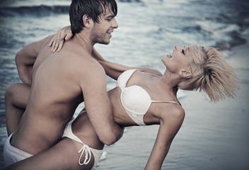 Joyful couple on the beach