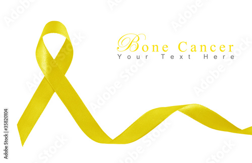Yellow Ribbon a Symbol of Bone Cancer with copy space