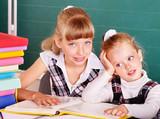 Schoolchildren in classroom near blackboard. poster