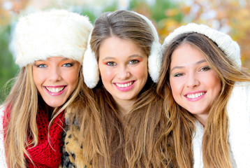 group of winter girls or young women with perfect white teeth