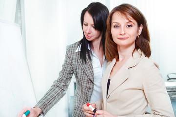 Businesswomen writing