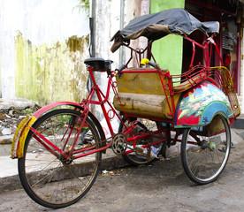 tricycle rickshaws on the streets of Yogyakarta