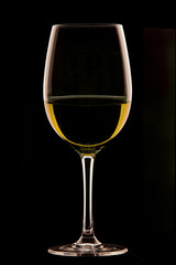 Glass of wine on black background.