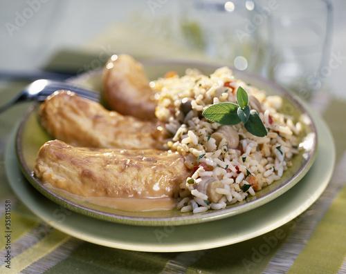 Quenelles de brochet sauce Nantua et riz