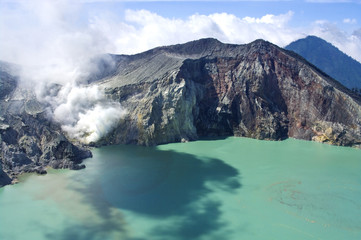 Sulphatic lake in a crater of volcano Ijen.