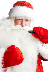 Traditional Santa Claus holding 3g usb modem in his arm on foreg