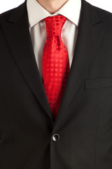 Red tie and suit detail
