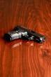 Nine millimeter handgun on a rwooden surface