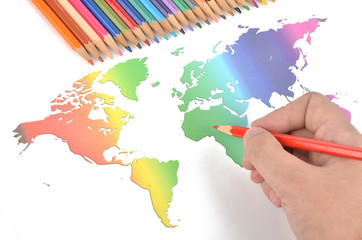 Color pencils and world map