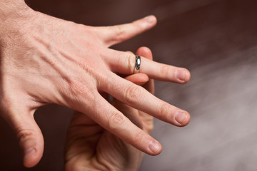Ring being placed onto man's finger