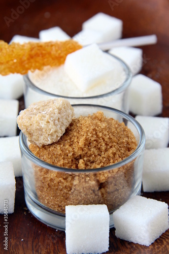 Several types of sugar - refined sugar, brown sugar