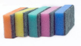 Five multi-colored sponges  isolated
