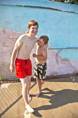 two brothers have fun at the pool