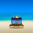 Travel Suitcase on a Caribbean Beach