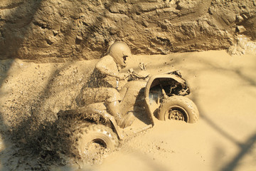 man badly stuck in mud with his quadbike