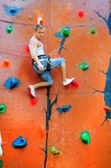 man climbing on a climbing wall