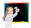cute little girl standing near blackboard