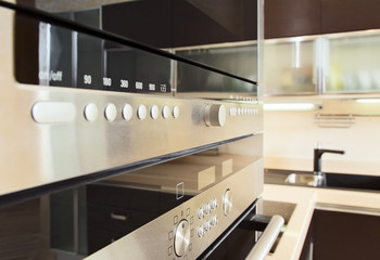 Build in microwave oven in modern kitchen interior with hardwood