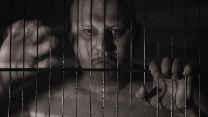 Prisoner in jail cell