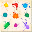 Set of colorful paint splats on old paper sheet
