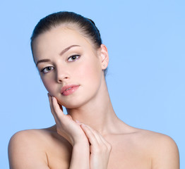 Beautiful face with healthy clean skin of young woman