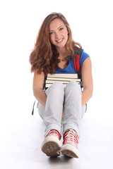 Teenage student girl sitting with study books