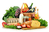 Fototapety Groceries in wicker basket including vegetables and fruits