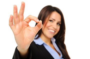 Business woman makes OK sign