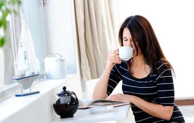 Enjoying her coffee