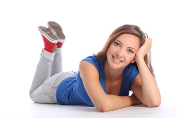 Happy pretty teenage school girl lying on floor