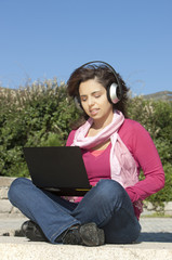 Girl with a laptop and headphones