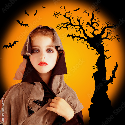 Halloween child girl with grunge dress