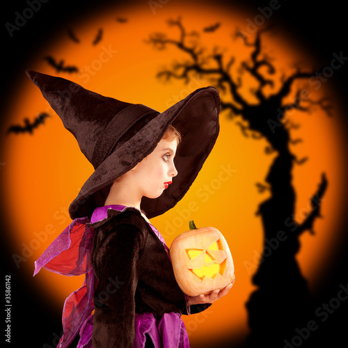 Halloween children girl holding pumpkin