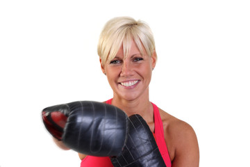 Attractive woman exercising with sparring gloves