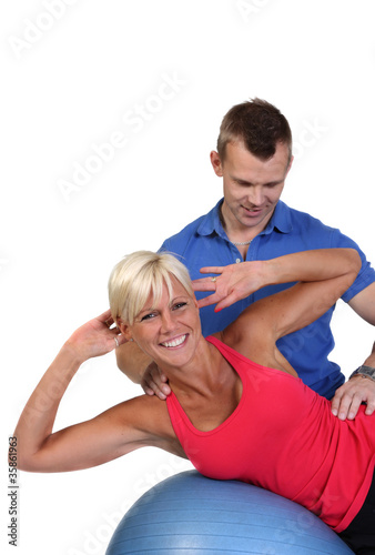 Attractive woman with her fitness coach