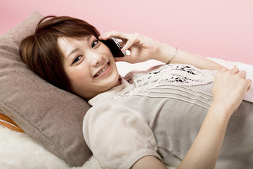 Asian beautiful woman talking by mobile phone