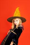 Halloween kid girl costume on orange