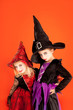 Halloween sister kid girls on orange