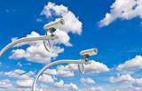 outdoor cctv cameras against blue sky poster