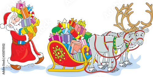 Santa loads his sleigh with Christmas gifts