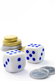 dice and coins on a white background