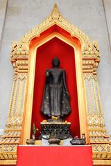 Standing buddha statue in Bangkok temple
