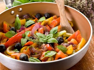 peperonata over casserole on wood background