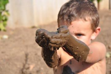 child and mud