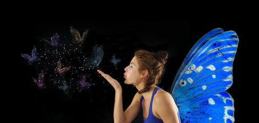 Fairy blowing butterflies