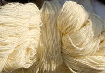 Roll of white woolen yarn.
