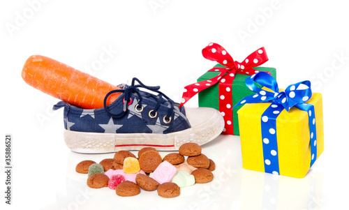 Dutch Sinterklaas concept with a carrot in a shoe and gifts and