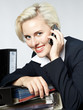 Portrait of a beautiful woman in the office with mobile phone